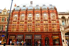 Old buildings Piccadilly Mayfair, London England. Majestic old traditional building of Bentley & Skinner at Piccadilly  Mayfair, City of Westminster, London Royalty Free Stock Photo