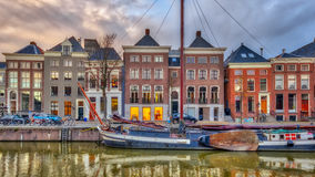 Old buildings on Quay with ship. Old buildings on Hoge der Aa Quay with ship in Groningen city centre at sunset, Netherlands Stock Photos