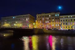 Old buildings on the river quay at night. Moon over the old houses in Saint Petersburg Royalty Free Stock Photos