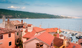 Old buildings roofs over harbor at Opatija. Shore, popular touristic destination, Adriatic coast, Croatia Stock Photos