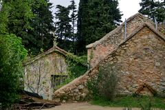 Old buildings and ruins in the middle of a large forest stock photos