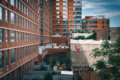 Old buildings seen from the High Line, in Manhattan, New York. Royalty Free Stock Image