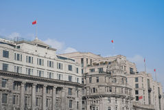 Old buildings of shanghai. At the Bund of Shanghai, with flags of China Royalty Free Stock Images