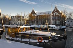 Old buildings and ships with snow. On sunny winterday - horizontal image Stock Photography