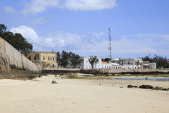 Old buildings on the shore of Island of mozambique. The Island of Mozambique (Portuguese: Ilha de Moçambique) lies off northern Mozambique, between the Stock Photography