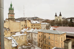 Old buildings and snow-covered roofs of the downtown in Lviv, Ukraine. Stock Image