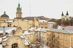 Old buildings and snow-covered roofs of the downtown in Lviv, Ukraine. Stock Images