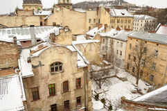 Old buildings and snow-covered roofs of the downtown in Lviv, Ukraine. Stock Photography