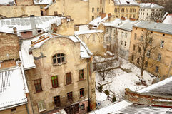 Old buildings and snow-covered roofs of the downtown in Lviv, Ukraine. Royalty Free Stock Photo