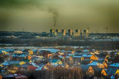 Village sky factory. Old buildings in the snow, a lot of homes new year`s eve Royalty Free Stock Images