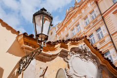 Old buildings and street lamp on the wall Royalty Free Stock Image