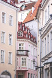 Old buildings of Tallin... Interesting impressive unusual photo of the Estonian Old Tallin: a few ancient close up standing buildings, bright orange, red and Royalty Free Stock Photography