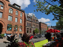 Old buildings, Toronto. TORONTO - 2016:  Tucked away among the high rises, Elm Street preserves fine old Victorian buildings and has outdoor restaurants Stock Photo