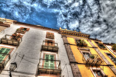 Old buildings under a cloudy sky in Bosa Royalty Free Stock Images