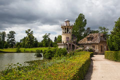 Old buildings in Versailles gardens Royalty Free Stock Photos