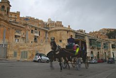 Old buildings and Victoria Cate in the Grand Harbor of Valletta. Stock Image
