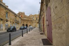 Old buildings and Victoria Cate in the Grand Harbor of Valletta. Royalty Free Stock Photos