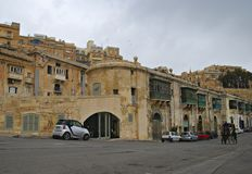 Old buildings and Victoria Cate in the Grand Harbor of Valletta. Royalty Free Stock Photo