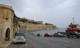 Old buildings and Victoria Cate in the Grand Harbor of Valletta. Stock Photography