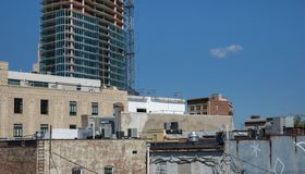 Old buildings vs new construction. Showing change of a cityscape. royalty free stock photo