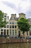 Old buildings on the waterfront canal in Amsterdam Royalty Free Stock Photos