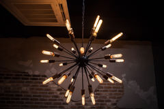 Old bulb electric lamp. In loft Royalty Free Stock Image