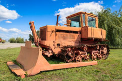 Old buldozer for general agricultural purpose, tractor type DT-75 Royalty Free Stock Photography