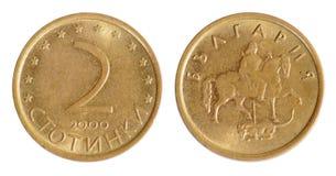 Old Bulgarian coin. On the white background. stotinki (2000 year royalty free stock photo