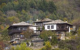 Old Bulgarian houses among the trees in the mountain Stock Photo