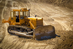 Old bulldozer on a building site. Road construction Stock Images