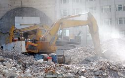 Old bulldozer. Destroyed building. Stock Photos