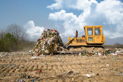 The old bulldozer moving garbage Royalty Free Stock Photo