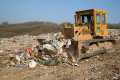 The old bulldozer moving garbage Stock Photo