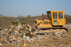 The old bulldozer moving garbage Royalty Free Stock Photos