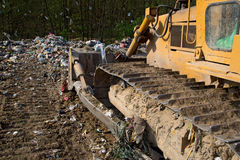 The old bulldozer moving garbage Royalty Free Stock Image