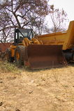 An Old Bulldozer on Scrap Yard in Africa Stock Photos