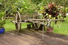 Old bullock cart. An historical conveyance decorating an hotel grounds here in Siem Reap, Cambodia stock photos