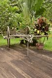 Old bullock cart. An historical conveyance decorating an hotel grounds here in Siem Reap, Cambodia stock images