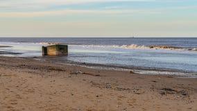 Newport, Norfolk, England, UK. An old bunker on the beach of Newport, Norfolk, England, UK stock photo