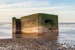 Newport, Norfolk, England, UK. An old bunker on the beach of Newport, Norfolk, England, UK royalty free stock images