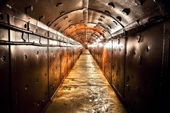 Old bunker's corridor. Old bunker during the Cold War. Corridor in the anti-nuclear bomb shelter royalty free stock photo