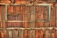 Old bunkhouse with metal cot Stock Photo