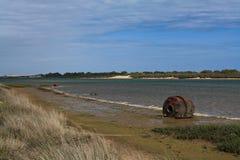Old buoy on beach Stock Photo