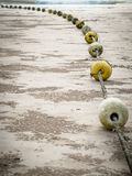 Old buoys on the beach Stock Images