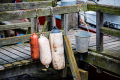 Old buoys on wooden bridge Royalty Free Stock Photography