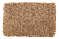 Old burlap canvas with lacerate. Very detailed hi res photo of an old burlap canvas with lacerate edge, for backgrounds, textures and layers Royalty Free Stock Photos