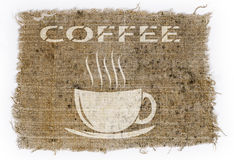 Old burlap on a white background with a picture of a Cup and the Stock Images