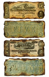 Old, Burned Confederate Five and Ten Dollar Bills. The front and back of two antique five and ten dollar bills that have been burned around the edges. Printed by Royalty Free Stock Photos