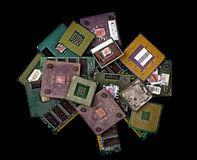 Old burned CPU chips and memory modules. On black background stock image