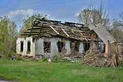 Old burned-out house in the village Stock Photos
